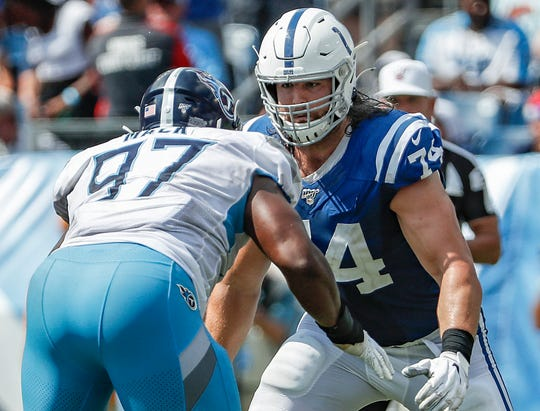 Indianapolis Colts offensive tackle Anthony Castonzo (74) wards off defensive tackle Isaiah Mack (97) in the third quarter of their game at Nissan Stadium in Nashville, Tenn., on Sunday, Sept. 15, 2019.