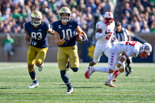 Notre Dame Fighting Irish wide receiver Chris Finke (10) runs for a touchdown in the third quarter against the New Mexico Lobos at Notre Dame Stadium.