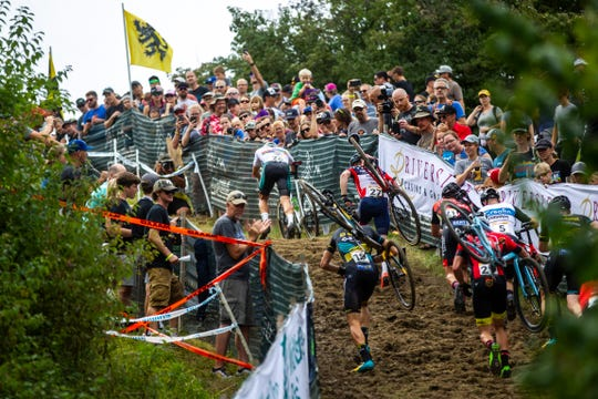 Competitors shoulder their bikes on a climb up Mt. Krumpit during the UCI Cyclo-Cross World Cup elite men's race, Saturday, Sept. 14, 2019, at the Johnson County Fairgrounds in Iowa City, Iowa.
