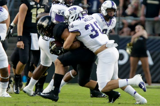 Texas Christian University linebacker Garret Wallow (30) tackles Purdue running back Zander Horvath (40) during the first quarter of a NCAA football game, Saturday, Sept. 14, 2019 at Ross-Ade Stadium in West Lafayette. Texas Christian University won, 34-13.