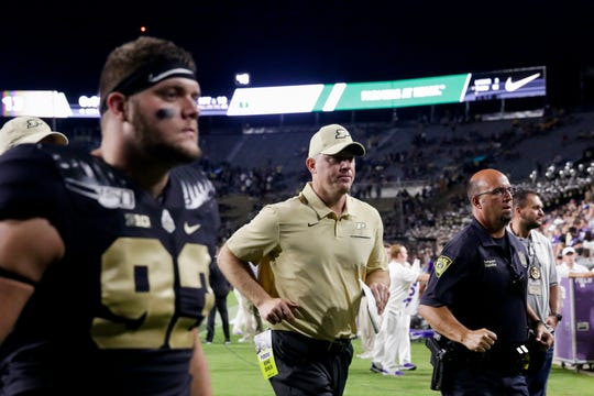 Purdue head coach Jeff Brohm jogs off the field after being defeated by Texas Christian University, 34-13, Saturday, Sept. 14, 2019 at Ross-Ade Stadium in West Lafayette.