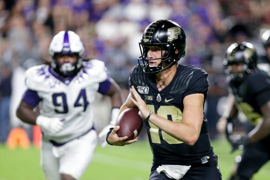 Purdue quarterback Jack Plummer (13) runs the ball during the third quarter of an NCAA football game, Saturday, Sept. 14, 2019 at Ross-Ade Stadium in West Lafayette.