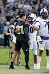 Purdue linebacker Markus Bailey (21) and Texas Christian University quarterback Alex Delton (16) embrace before the start of the first quarter of an NCAA football game, Saturday, Sept. 14, 2019 at Ross-Ade Stadium in West Lafayette. Texas Christian University won, 34-13.