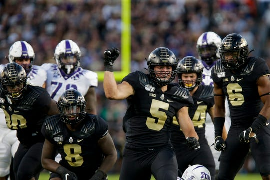 Purdue defensive end George Karlaftis (5) celebrates a sack during the first quarter of a NCAA football game, Saturday, Sept. 14, 2019 at Ross-Ade Stadium in West Lafayette.