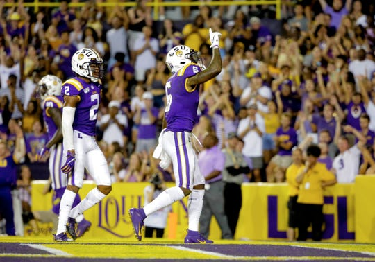 Sep 14, 2019; Baton Rouge, LA, USA; LSU Tigers wide receiver Terrace Marshall Jr. (6) celebrates with wide receiver Jaray Jenkins (83) after a touchdown catch against the Northwestern State Demons during the second quarter at Tiger Stadium. Mandatory Credit: Derick E. Hingle-USA TODAY Sports