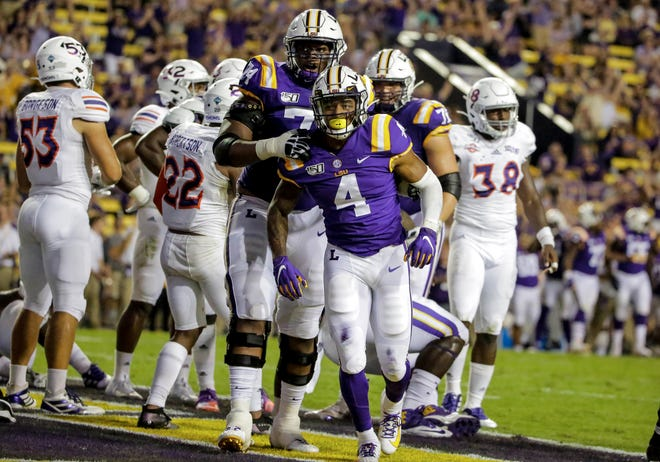 Sep 14, 2019; Baton Rouge, LA, USA; LSU Tigers running back John Emery Jr. (4) celebrates with offensive tackle Badara Traore (74) after a touchdown against the Northwestern State Demons during the third quarter at Tiger Stadium. Mandatory Credit: Derick E. Hingle-USA TODAY Sports