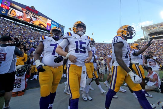 LSU Tigers quarterback Myles Brennan (15) and the Tigers take the field during an NCAA football game between the Georgia Southern Eagles and Louisiana State University Tigers in Baton Rouge, La., Saturday, Aug. 31, 2019. (AP Photo/Michael Democker)