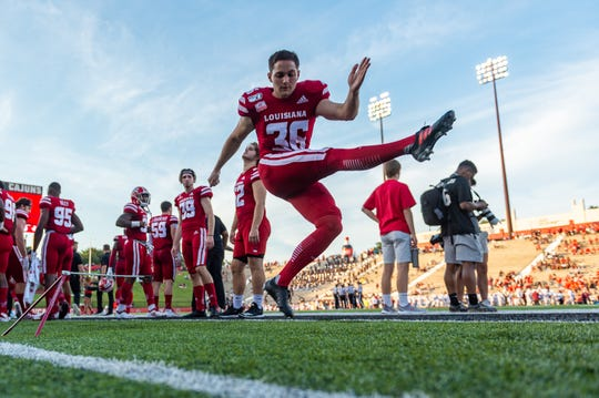 UL kicker Stevie Artigue practices on the sidelines as the Ragin' Cajuns take on Texas Southern Sept. 14.