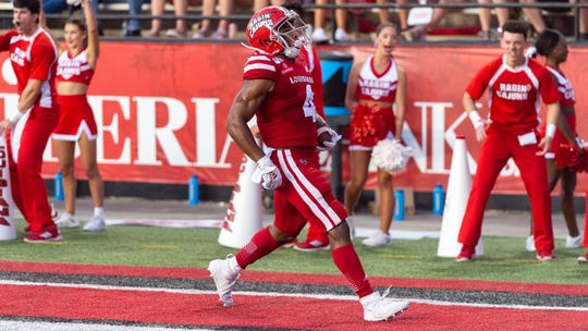 UL running back Raymond Calais (4) scores a touchdown as the Ragin' Cajuns take on Texas Southern Saturday, Sept. 14, 2019.