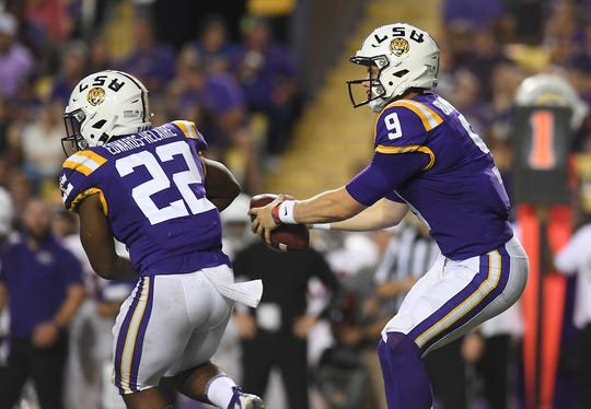 LSU quarterback Joe Burrow (9) fakes a handoff to running back Clyde Edwards-Helaire (22) before throwing a pass in the first half of an NCAA college football game against Northwestern State, Saturday, Sept. 14, 2019, in Baton Rouge, La. (AP Photo/Patrick Dennis)