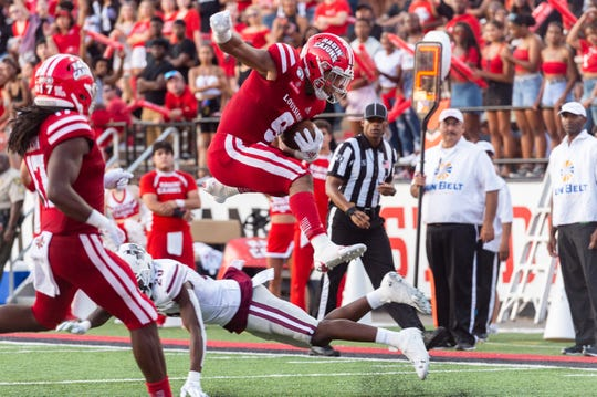 UL running back Trey Ragas leaps over a would-be tackler to score a touchdown as the Ragin' Cajuns take on Texas Southern Saturday, Sept. 14, 2019.