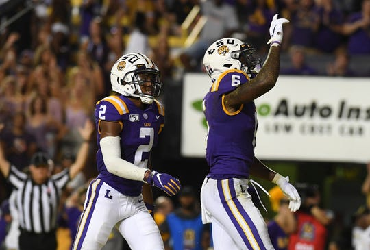 LSU wide receiver Terrace Marshall Jr. (6) celebrates a touchdown catch with teammate Justin Jefferson (2) in the first half of an NCAA college football game against Northwestern State, Saturday, Sept. 14, 2019, in Baton Rouge, La. (AP Photo/Patrick Dennis)
