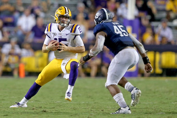 LSU Tigers quarterback Myles Brennan (15) scrambles in the fourth quarter during an NCAA football game between the Georgia Southern Eagles and Louisiana State University Tigers in Baton Rouge, La., Saturday, Aug. 31, 2019. (AP Photo/Michael Democker)