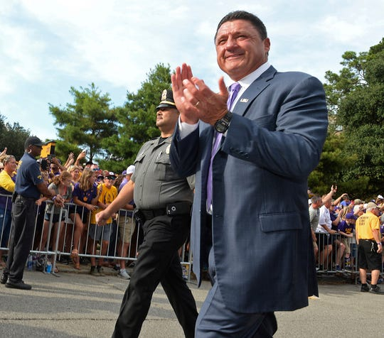 LSU head football coach Ed Orgeron claps as he and the team walk down the hill to Tiger Stadium before an NCAA college football game against Northwestern State, Saturday, Sept. 14, 2019, in Baton Rouge, La. (AP Photo/Patrick Dennis)