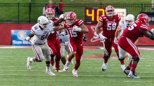 Elijah Mitchell runs the ball as the Louisiana Ragin Cajuns take on Texas Southern. Saturday, Sept. 14, 2019.