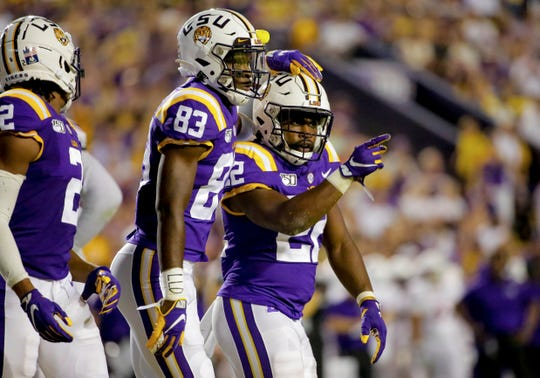 Sep 14, 2019; Baton Rouge, LA, USA; LSU Tigers running back Clyde Edwards-Helaire (22) celebrates with wide receiver Jaray Jenkins (83) during the second quarter against the Northwestern State Demons at Tiger Stadium. Mandatory Credit: Derick E. Hingle-USA TODAY Sports