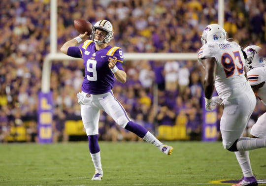 Sep 14, 2019; Baton Rouge, LA, USA; LSU Tigers quarterback Joe Burrow (9) throws under pressure from Northwestern State Demons defensive end Ty Cormier (93) during the second quarter at Tiger Stadium. Mandatory Credit: Derick E. Hingle-USA TODAY Sports