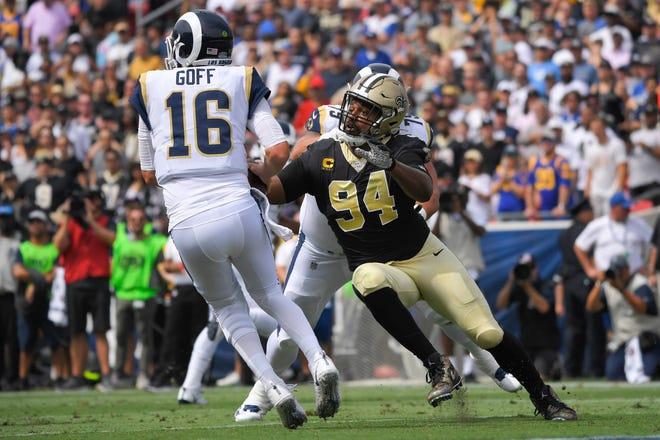 New Orleans Saints defensive end Cameron Jordan looks to sack Los Angeles Rams quarterback Jared Goff during the first half of an NFL football game Sunday, Sept. 15, 2019, in Los Angeles. (AP Photo/Mark J. Terrill)