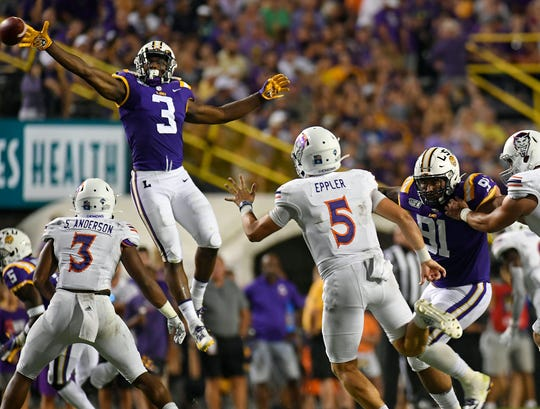 LSU safety Jacoby Stevens (3) tries to block a pass by Northwestern State quarterback Shelton Eppler (5) in the first half of an NCAA college football game, Saturday, Sept. 14, 2019, in Baton Rouge, La. (AP Photo/Patrick Dennis)