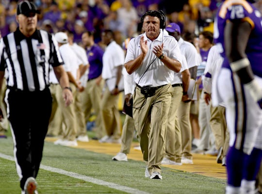 LSU head coach Ed Orgeron claps after an LSU score in the first half of an NCAA college football game against Northwestern State, Saturday, Sept. 14, 2019, in Baton Rouge, La. (AP Photo/Patrick Dennis)