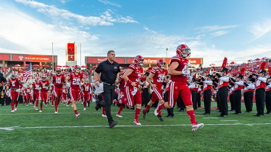 UL head football coach Billy Napier leads his Ragin' Cajuns onto the field against Texas Southern Sept. 14.