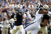 New Orleans Saints quarterback Teddy Bridgewater is pressured in Sunday's game against the Los Angeles Rams.