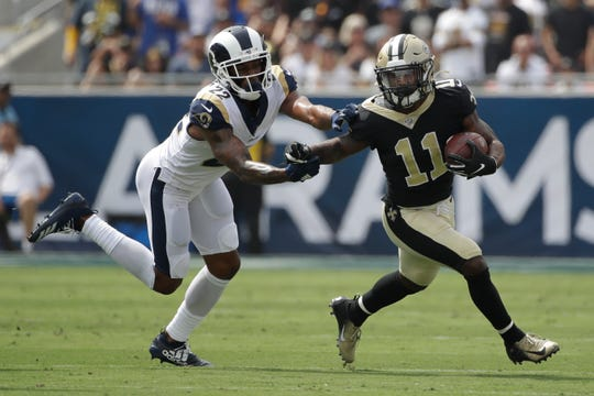 New Orleans Saints wide receiver Deonte Harris, right, runs past Los Angeles Rams cornerback Marcus Peters during the first half of an NFL football game Sunday, Sept. 15, 2019, in Los Angeles. (AP Photo/Marcio Jose Sanchez)