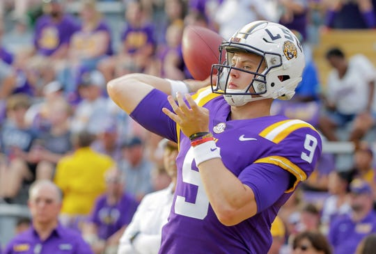 Sep 14, 2019; Baton Rouge, LA, USA; LSU Tigers quarterback Joe Burrow (9) warms up prior to kickoff against the Northwestern State Demons at Tiger Stadium. Mandatory Credit: Derick E. Hingle-USA TODAY Sports