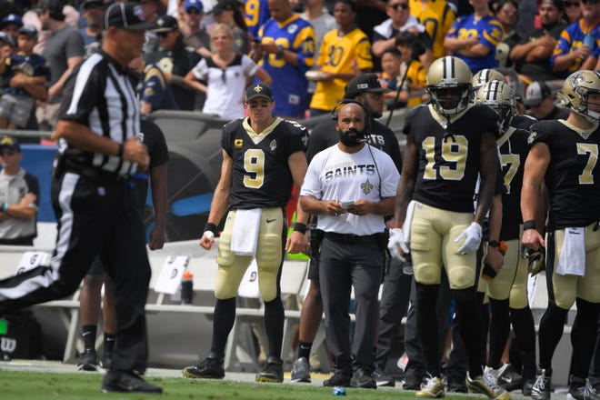 New Orleans Saints quarterback Drew Brees stands on the sidelines after a injury during the first half of an NFL football game against the Los Angeles Rams Sunday, Sept. 15, 2019, in Los Angeles. (AP Photo/Mark J. Terrill)