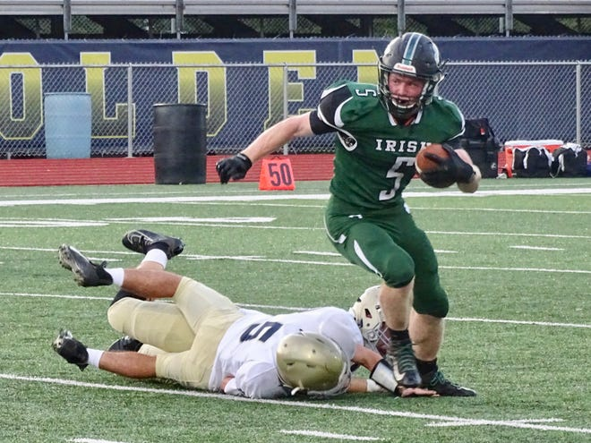 Fisher Catholic junior running back Nick Krooner breaks free from a pair od Portsmouth Notre Dame defenders during Saturday's 55-6 win at Fulton Field.