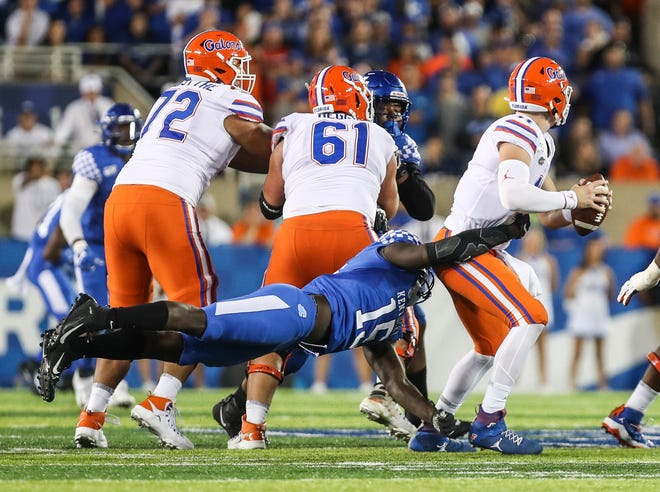 Kentucky's Jordan Wright pressures Florida quarterback Kyle Trask in the second half of last year's game.
