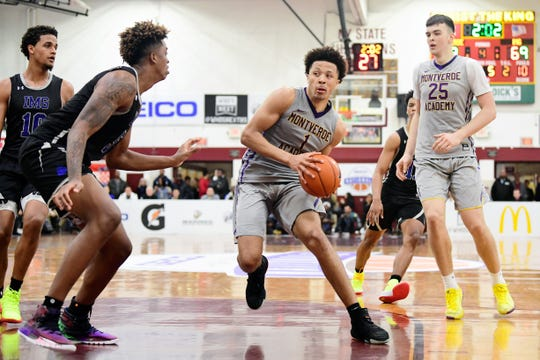 Montverde Academy Eagles guard Cade Cunningham is rated the No. 2 recruit by ESPN and 247Sports in their preseason rankings.   Here Cunningham (1) drives the ball to the basket against the IMG Academy Ascenders during the fourth quarter at Christ the King High School.