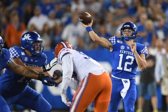 UK QB Sawyer Smith passes the ball during the University of Kentucky football game against University of Florida at Kroger Field in Lexington, Kentucky on Saturday, September 14, 2019.