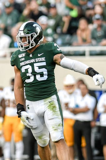 Michigan State's Joe Bachie celebrates after a stop during the third quarter on Saturday, Sept. 14, 2019, in East Lansing.