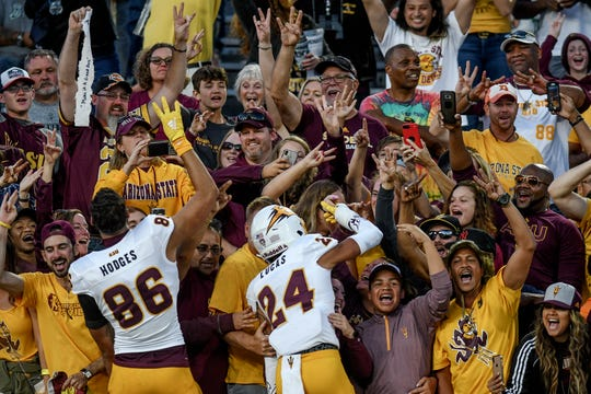 Arizona State fans celebrate with team members Curtis Hodges, left, and Chase Lucas after the game on Saturday, Sept. 14, 2019, in East Lansing.