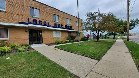 Workers leave UAW Local 602's hall in Lansing, Michigan on Sunday afternoon Sept. 15, 2019, just hours before they expect to begin a national strike against General Motors Co. after contract negotiations bogged down.