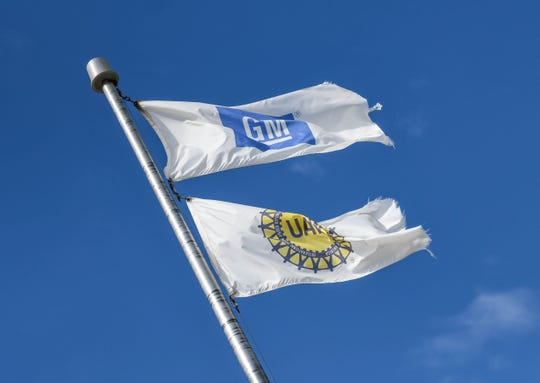 Tattered GM and UAW flags seen outside of the Lansing Delta GM plant Sunday, Sept. 15, 2019.  Autoworkers in Lansing officially go on strike at midnight after UAW leadership voted to do so this morning.  Thousands of GM workers in Lansing will be affected after the UAW called Sunday morning for a nationwide strike against General Motors.