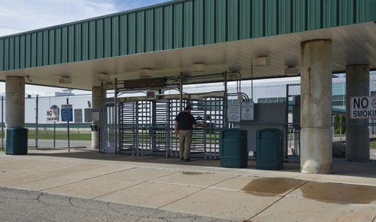 A man enters the GM Lansing Delta plant Sunday, Sept. 15, 2019.  GM autoworkers in Lansing officially go on strike at midnight after UAW leadership voted to do so this morning.  Thousands of GM workers in Lansing will be affected after the UAW called Sunday morning for a nationwide strike against General Motors.