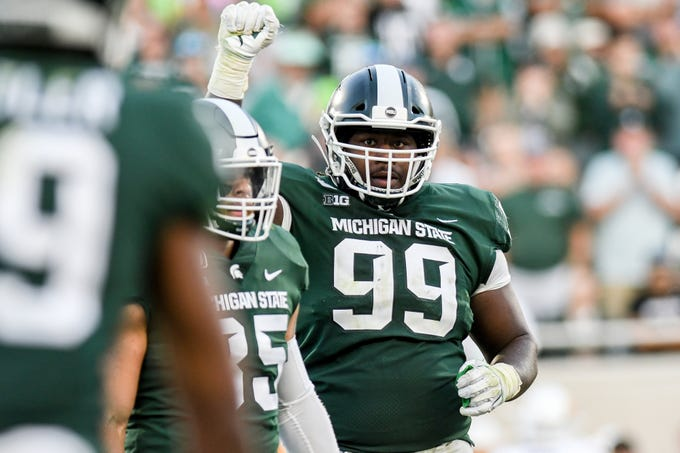 Michigan State's Raequan Williams pumps up the crowd during the third quarter on Saturday, Sept. 14, 2019, in East Lansing.
