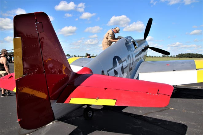 A view of the famous red tail of a P-51 Mustang flown in combat missions by the Tuskegee Airmen during World War II.
