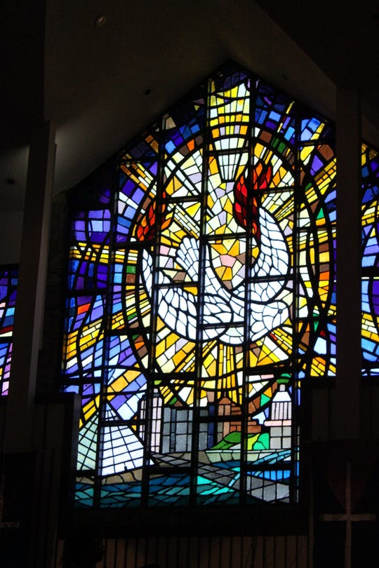 A stained glass window showing the Memphis skyline lit up the back of Mt. Vernon Baptist Church Westwood, where the Memphis Interfaith Coalition for Action and Hope held its second meeting with public officials.