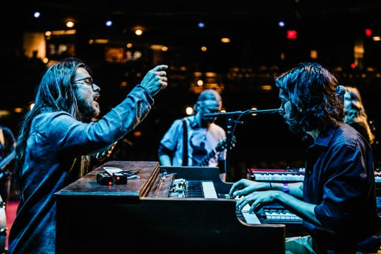 Wauwatosa native Logan Metz on keys works out a song with Lukas Nelson during a sound check at the Moody Theatre in Austin, Texas.