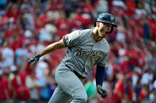 Sep 15, 2019; St. Louis, MO, USA; Milwaukee Brewers left fielder Ryan Braun (8) celebrates after hitting a grand slam off of St. Louis Cardinals relief pitcher Junior Fernandez (not pictured) during the ninth inning at Busch Stadium. Mandatory Credit: Jeff Curry-USA TODAY Sports