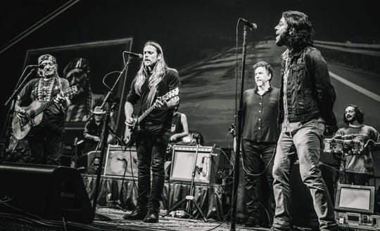Wauwatosa native Logan Metz (right, behind the microphone) was college friends with Lukas Nelson (center) and joined his band Promise of the Real last year. He's shared the stage several times with Lukas' father, the legendary Willie Nelson (far left).