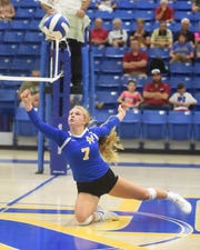 Mountain Home's Leah Jackson keeps a point going during a recent match at The Hangar. The Lady Bombers placed third at the West Plains tournament on Saturday.