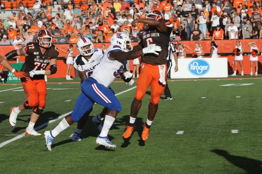 Louisiana Tech defense pressures Bowling Green's quarterback during Saturday's game at Doyt Perry Stadium.