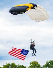 Cadet Camm Johnson from the West Point parachute team dropped into Memorial Field prior to Butler's football game on Friday night