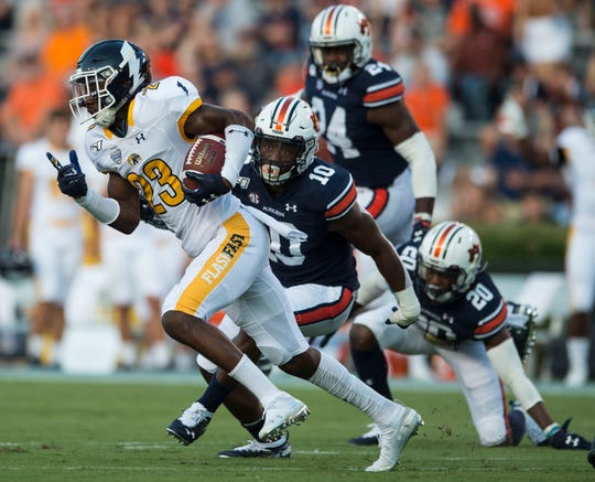 Kent State wide receiver Isaiah McKoy (23) evades tacklers after a catch at Jordan-Hare Stadium in Auburn, Ala., on Saturday, Sept. 14, 2019.