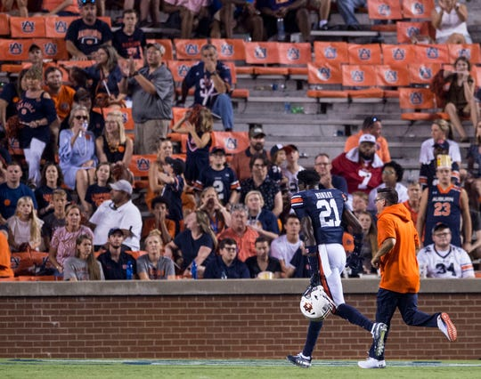 Auburn defensive back Smoke Monday (21) is walked off the field after he was ejected for a targeting penalty at Jordan-Hare Stadium in Auburn, Ala., on Saturday, Sept. 14, 2019. Auburn defeated Kent State 55-16.