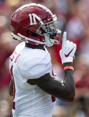 Alabama wide receiver Henry Ruggs, III, (11) celebrates his touchdown against South Carolina at Williams-Brice Stadium in Columbia, S.C., on Saturday September 14, 2019.